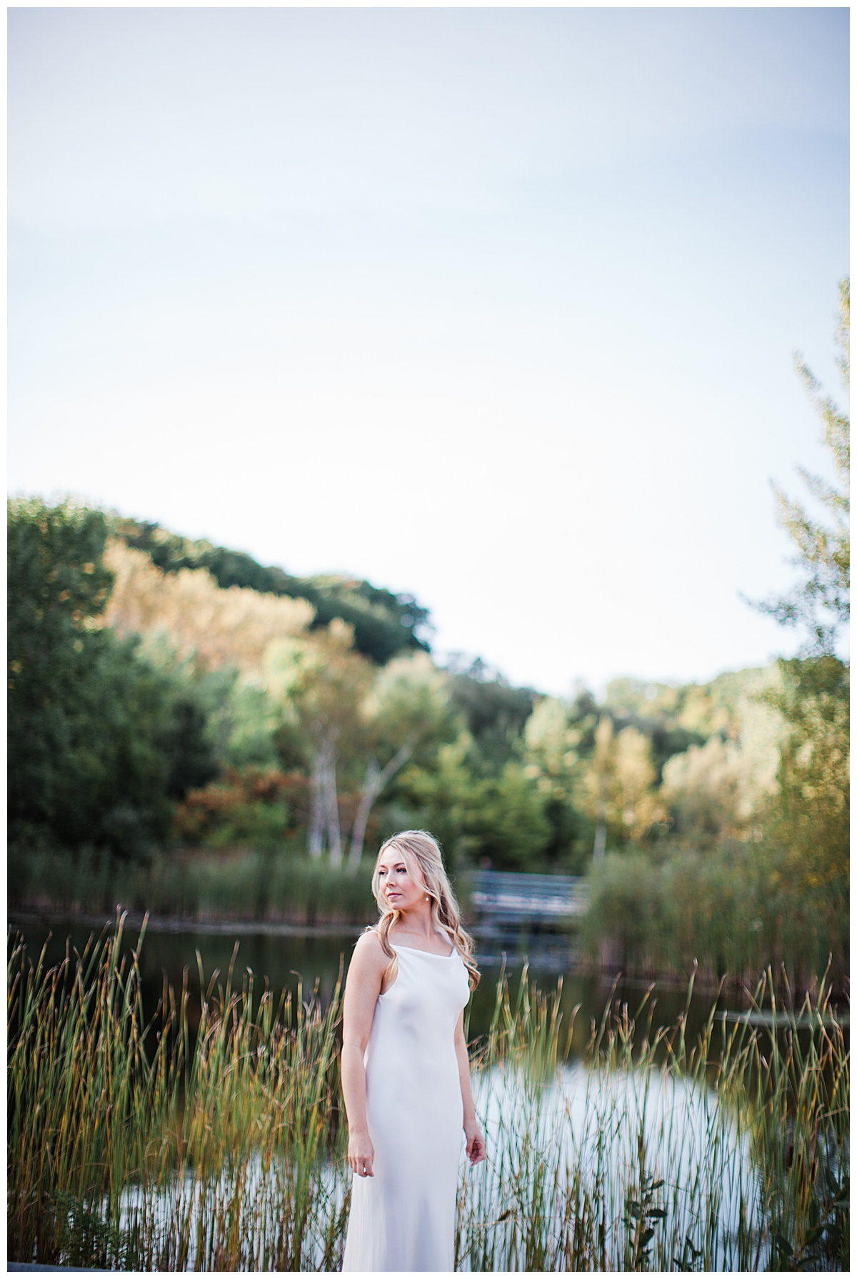 Bride standing by lake