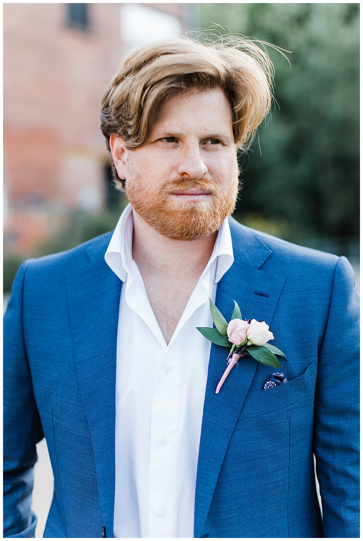 Close up groom portrait in blue and white