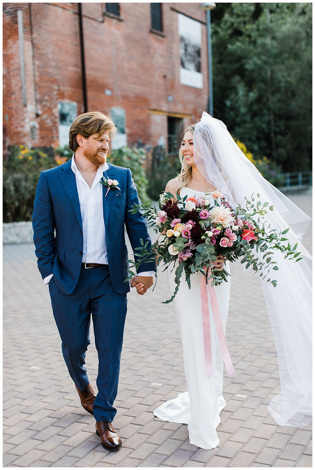 Bride and groom walking at the jam factory Canada wedding