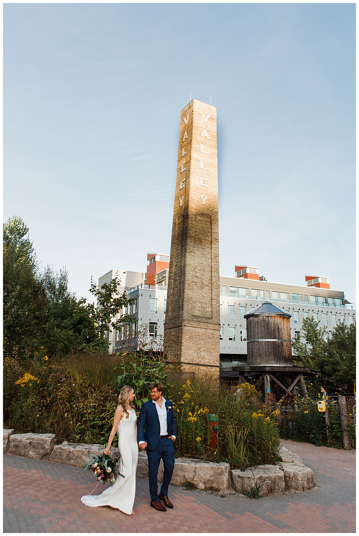 Bride and groom walking outside the jam factory Canada