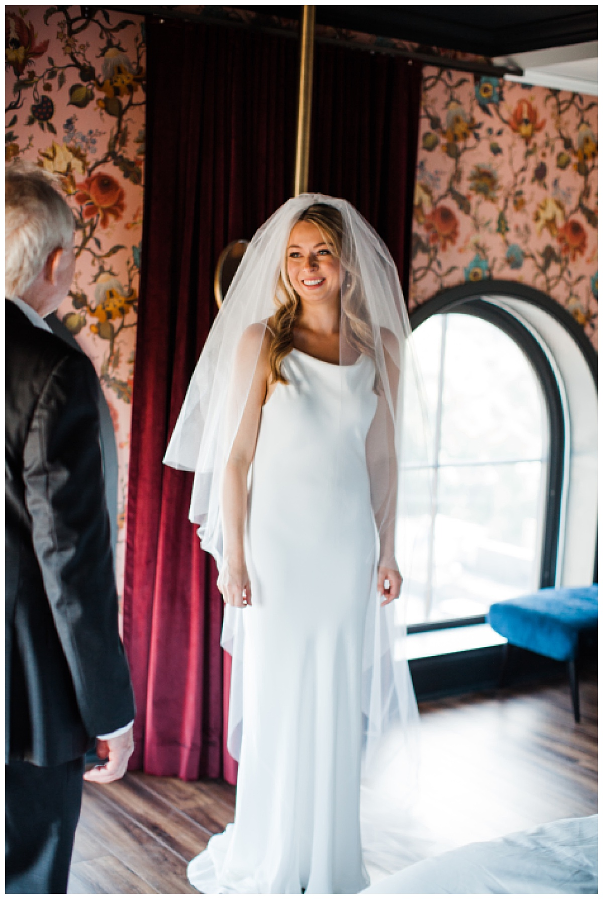 Bride smiling at father at first look