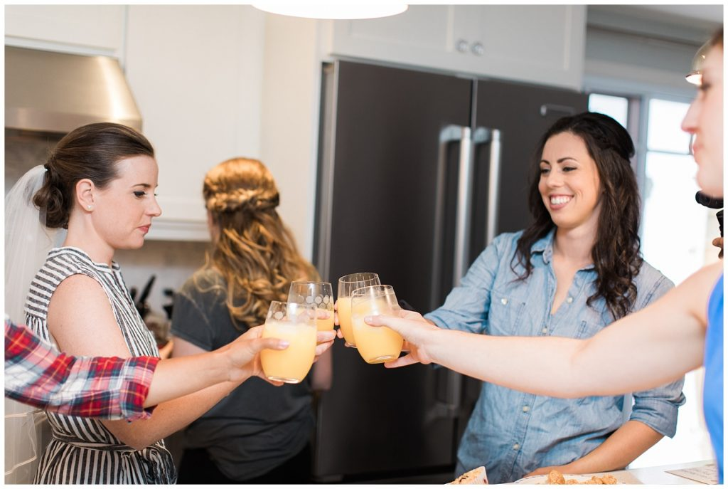 Bride and bridesmaids having mimosas before the ceremony at Guelph Ontario Wedding | Ontario Wedding Photographer | Toronto Wedding Photographer | 3photography
