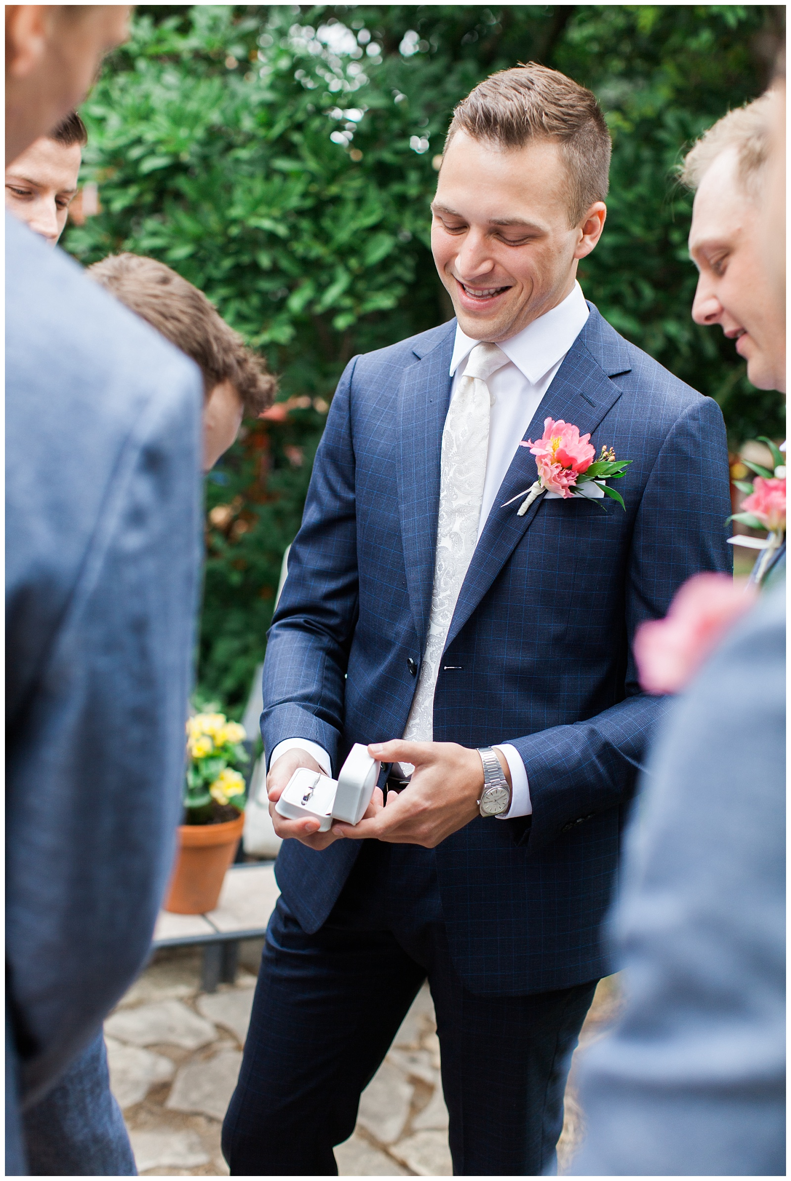 Groom showing the rings to his groomsmen at Guelph Ontario Wedding | Ontario Wedding Photographer | Toronto Wedding Photographer | 3photography
