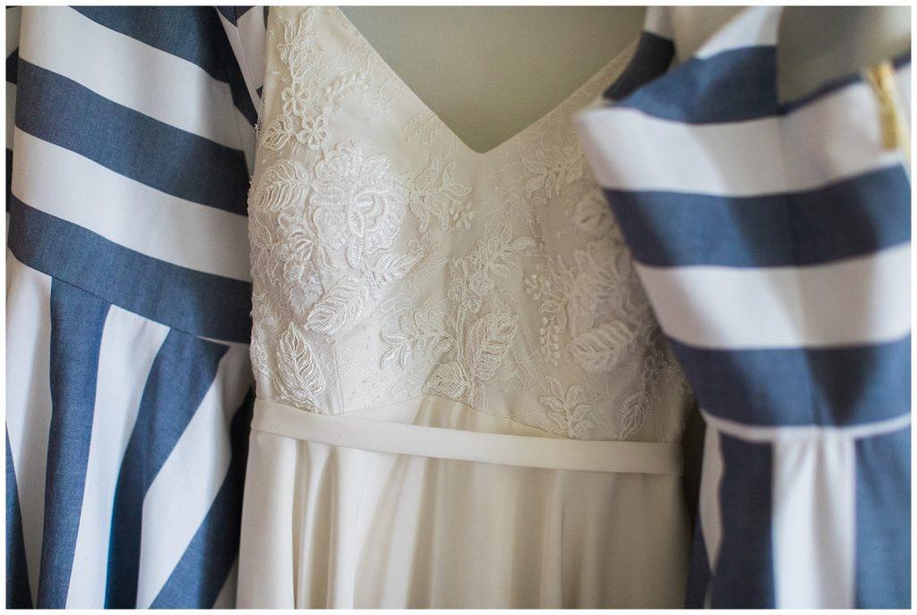 Wedding dress nestled between bridesmaid dresses at Guelph Ontario Wedding | Ontario Wedding Photographer | Toronto Wedding Photographer | 3photography