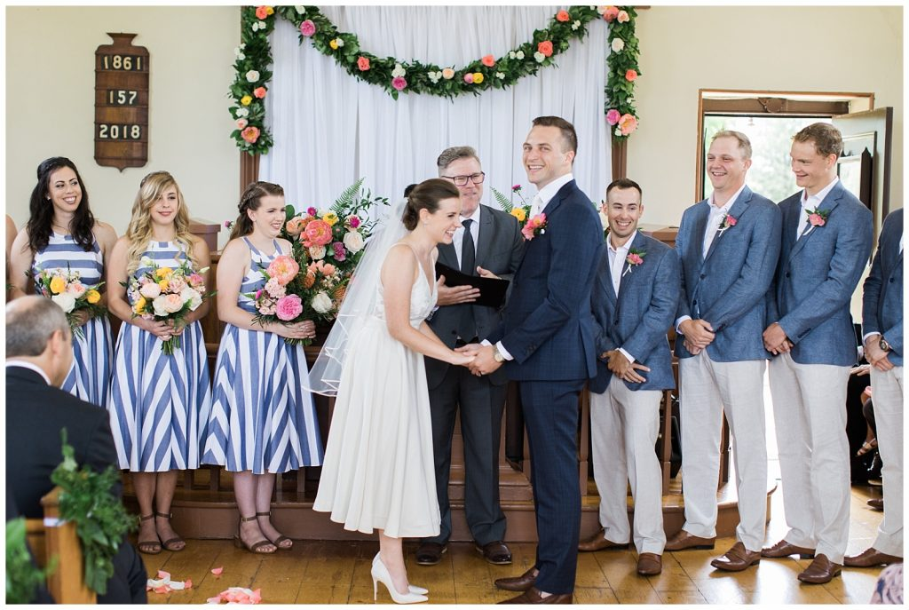 Bride and groom holding hands and laughing at alter at Guelph Ontario Wedding | Ontario Wedding Photographer | Toronto Wedding Photographer | 3photography