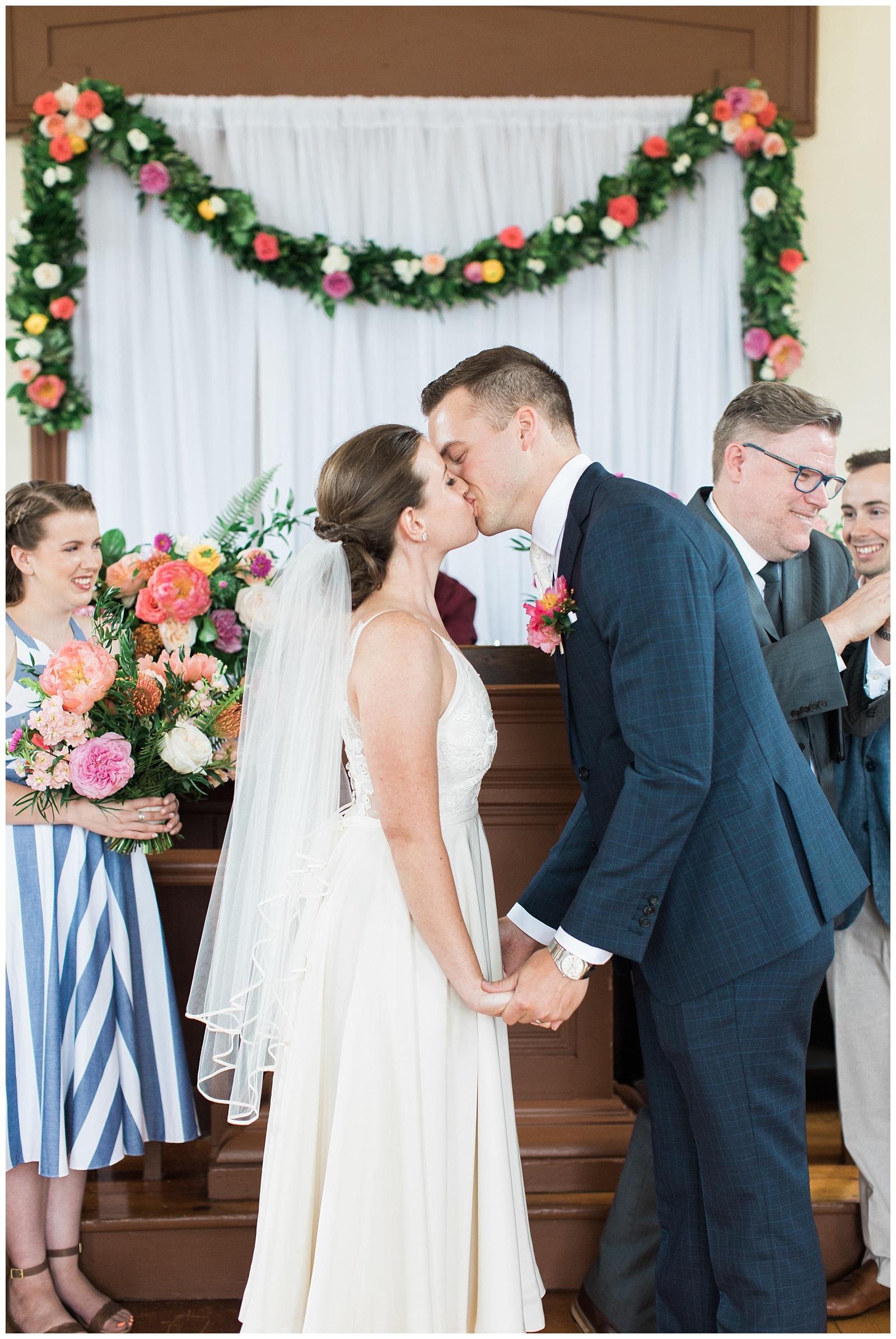 Bride and groom kiss at alter at Guelph Ontario Wedding | Ontario Wedding Photographer | Toronto Wedding Photographer | 3photography