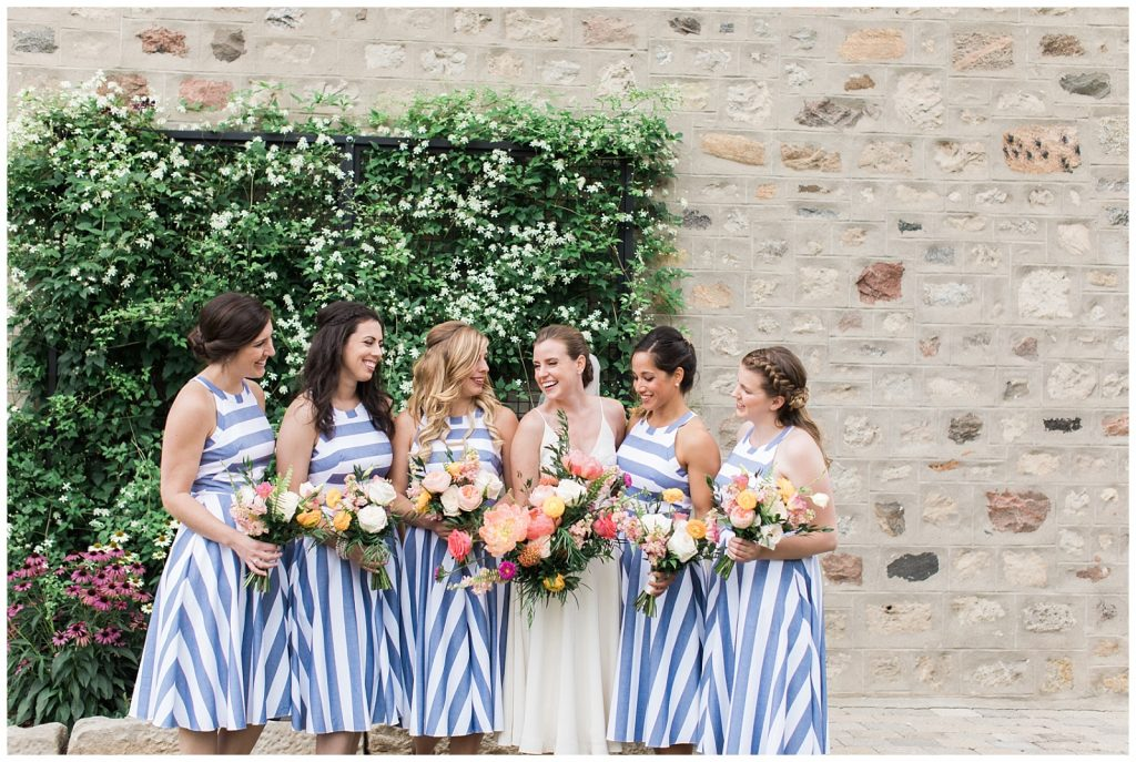 Bridesmaids laughing with the bride all holding bouquets at Guelph Ontario Wedding | Ontario Wedding Photographer | Toronto Wedding Photographer | 3photography