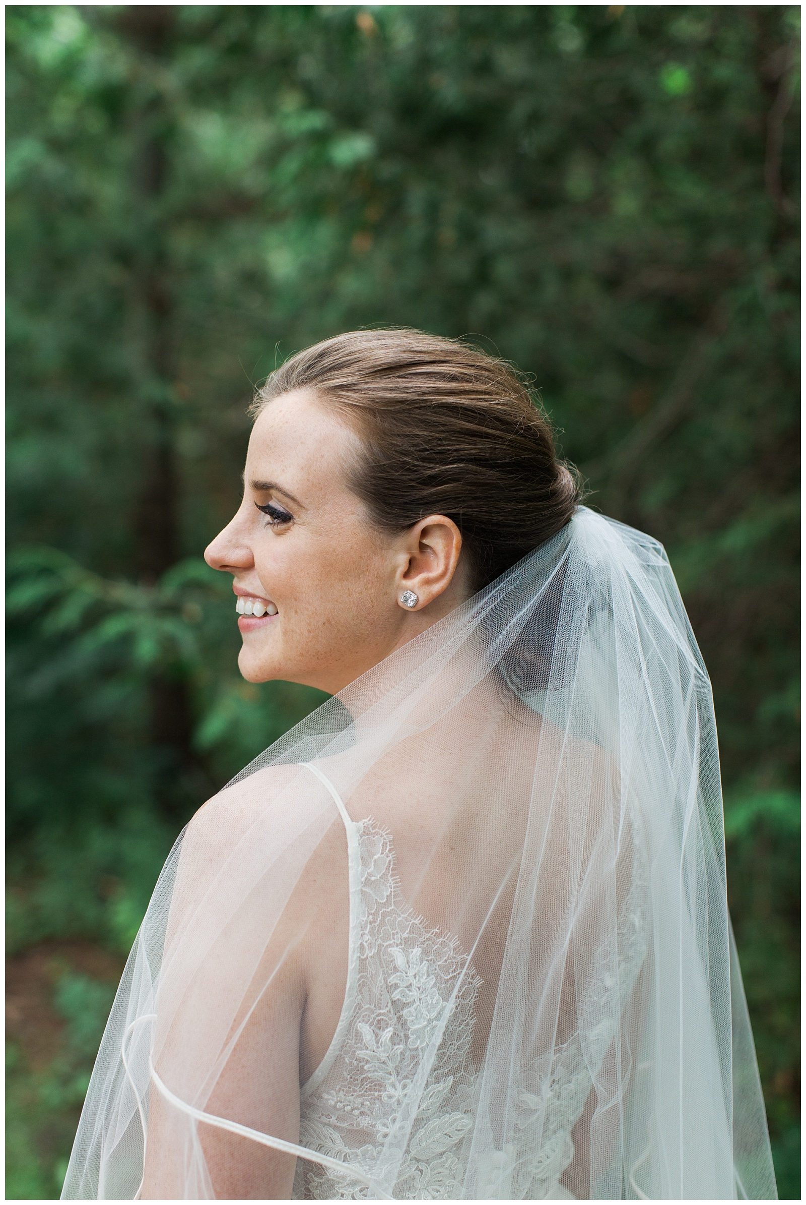 Bride smiling in veil with greenery in background at Guelph Ontario Wedding | Ontario Wedding Photographer | Toronto Wedding Photographer | 3photography