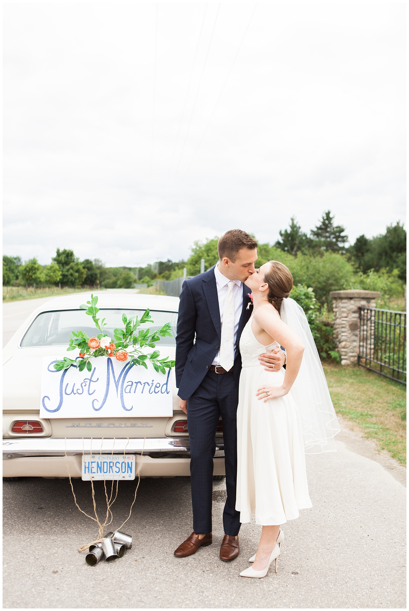 Bride and groom kissing in front of just married getaway car at Guelph Ontario Wedding | Ontario Wedding Photographer | Toronto Wedding Photographer | 3photography
