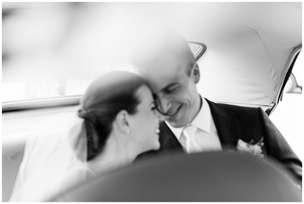 Black and white bride and groom nuzzling in back of getaway car at Guelph Ontario Wedding | Ontario Wedding Photographer | Toronto Wedding Photographer | 3photography