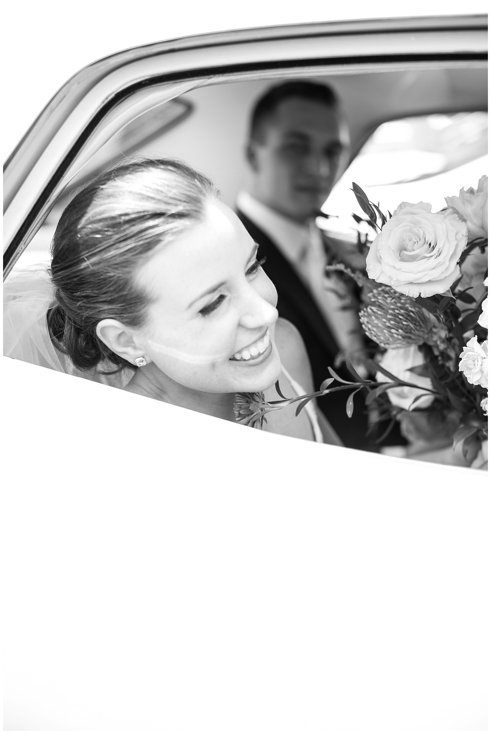 Black and white shot of smiling out the window in the getaway car at Guelph Ontario Wedding | Ontario Wedding Photographer | Toronto Wedding Photographer | 3photography