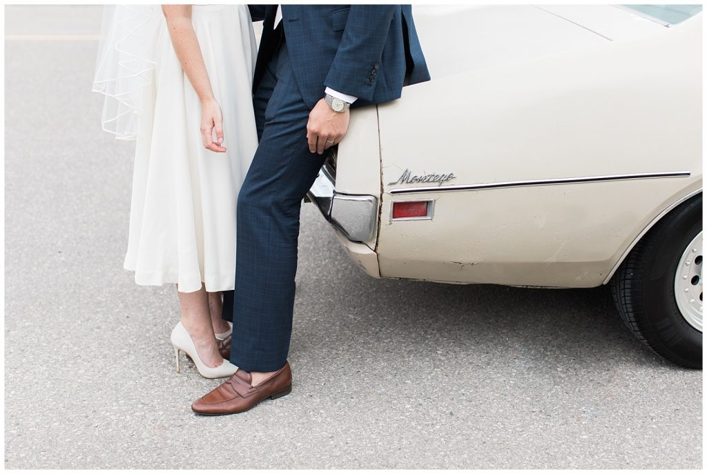Waist down photo of bride and groom leaning into each other against vintage car at Guelph Ontario Wedding | Ontario Wedding Photographer | Toronto Wedding Photographer | 3photography