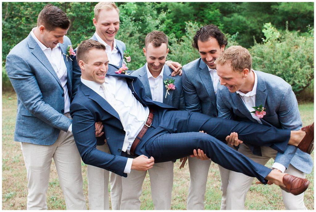 Groomsmen laughing and picking up groom at Guelph Ontario Wedding | Ontario Wedding Photographer | Toronto Wedding Photographer | 3photography