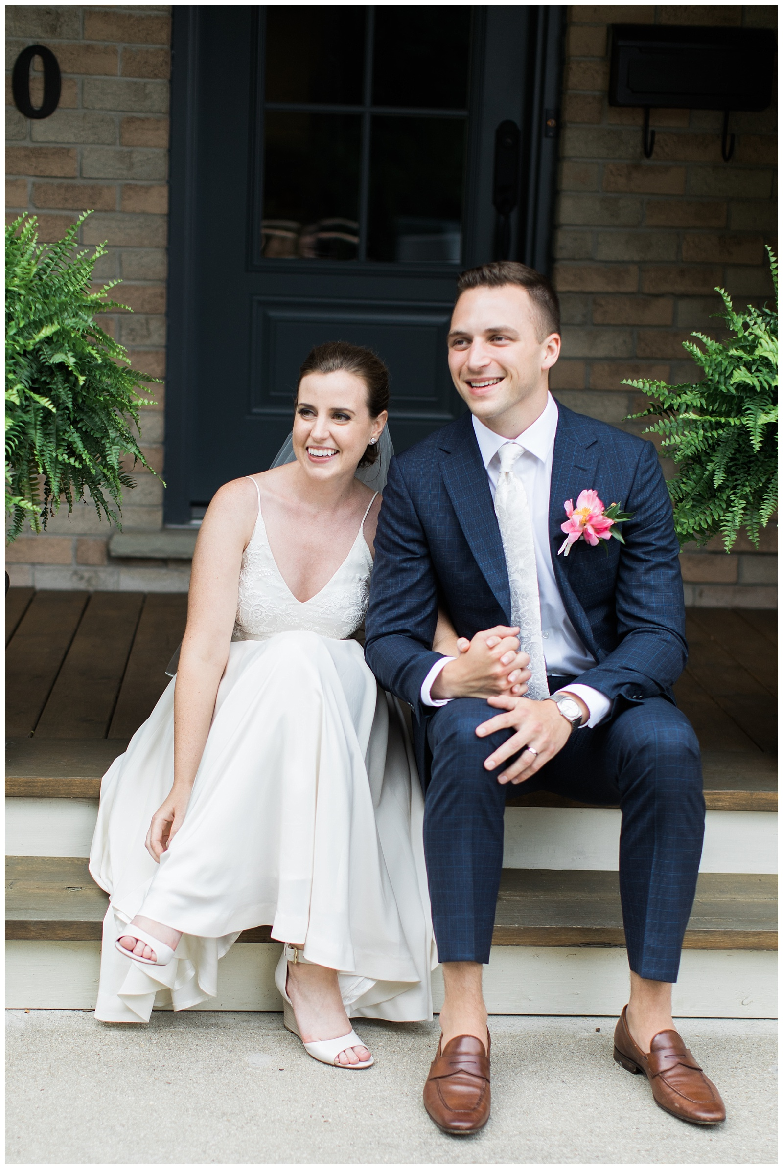 Bride and Groom holding hands and sitting on porch at Guelph Ontario Wedding | Ontario Wedding Photographer | Toronto Wedding Photographer | 3photography