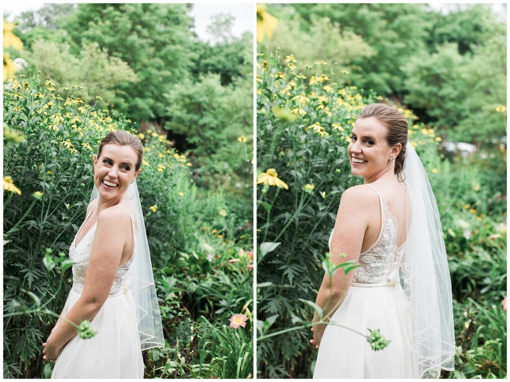 Gorgeous smiling bride looking back over her shoulder in gardens at Guelph Ontario Wedding | Ontario Wedding Photographer | Toronto Wedding Photographer | 3photography