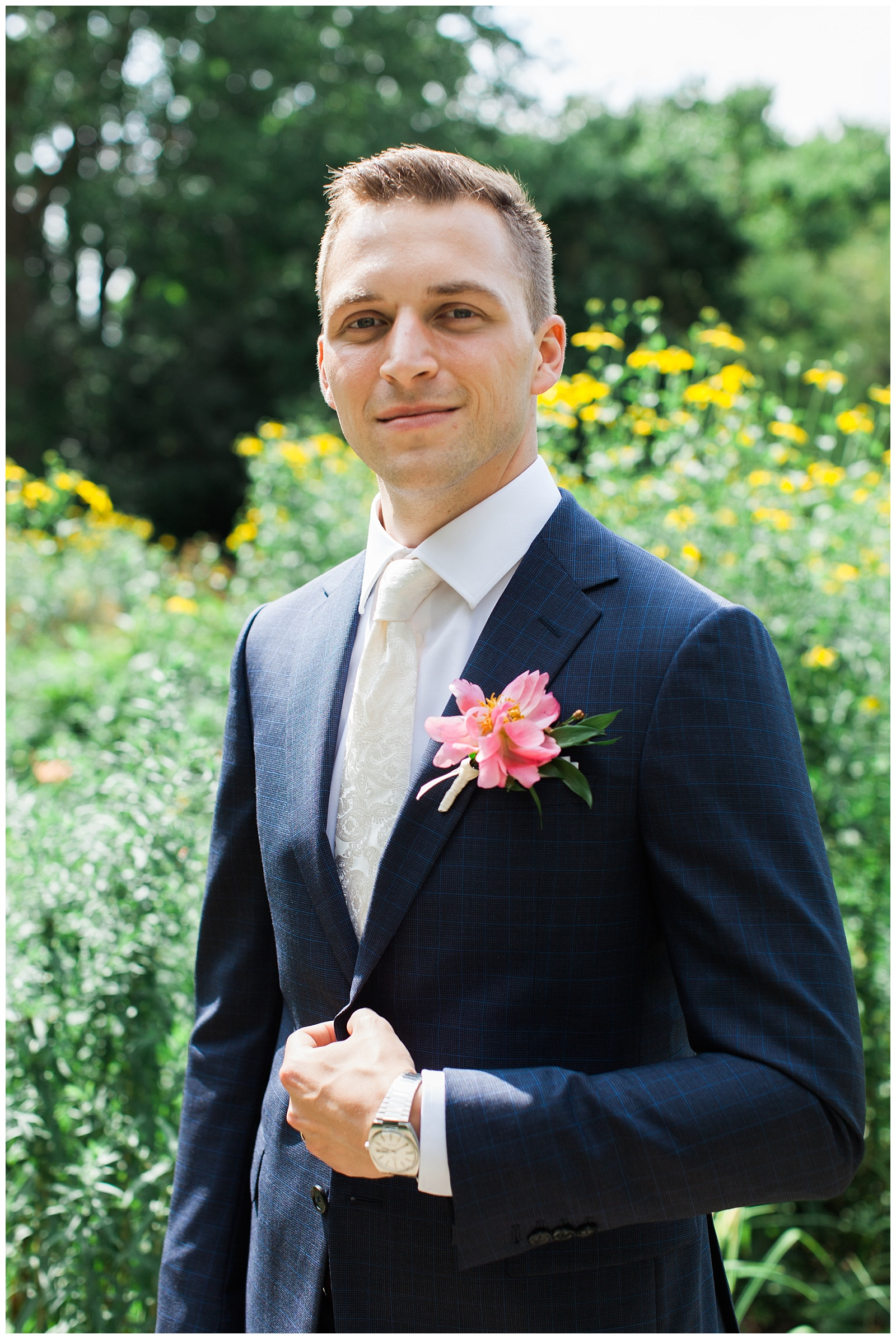 Handsome groom in navy pinstripe suit with watch and pink boutonniere at Guelph Ontario Wedding | Ontario Wedding Photographer | Toronto Wedding Photographer | 3photography