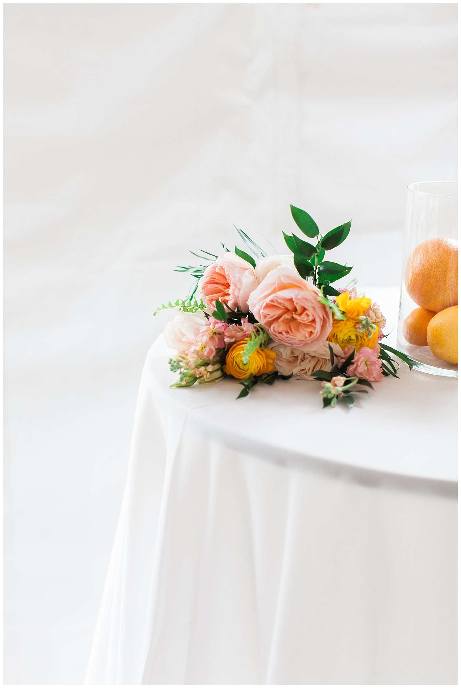 Centerpiece detail shot of floral bouquet and lemons on white table at Guelph Ontario Wedding | Ontario Wedding Photographer | Toronto Wedding Photographer | 3photography