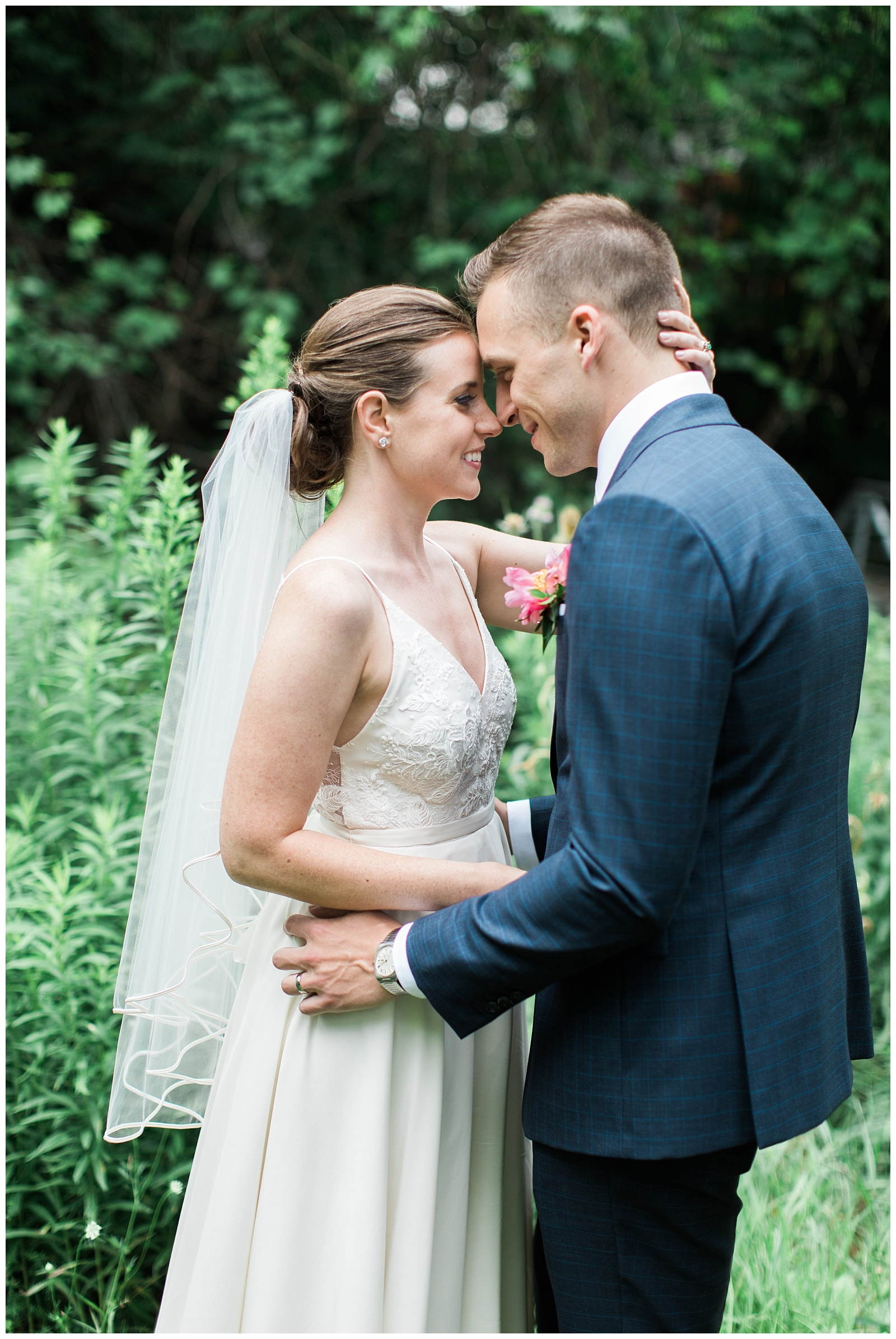 Bride and Groom touching noses in embrace with greenery backdrop at Guelph Ontario Wedding | Ontario Wedding Photographer | Toronto Wedding Photographer | 3photography
