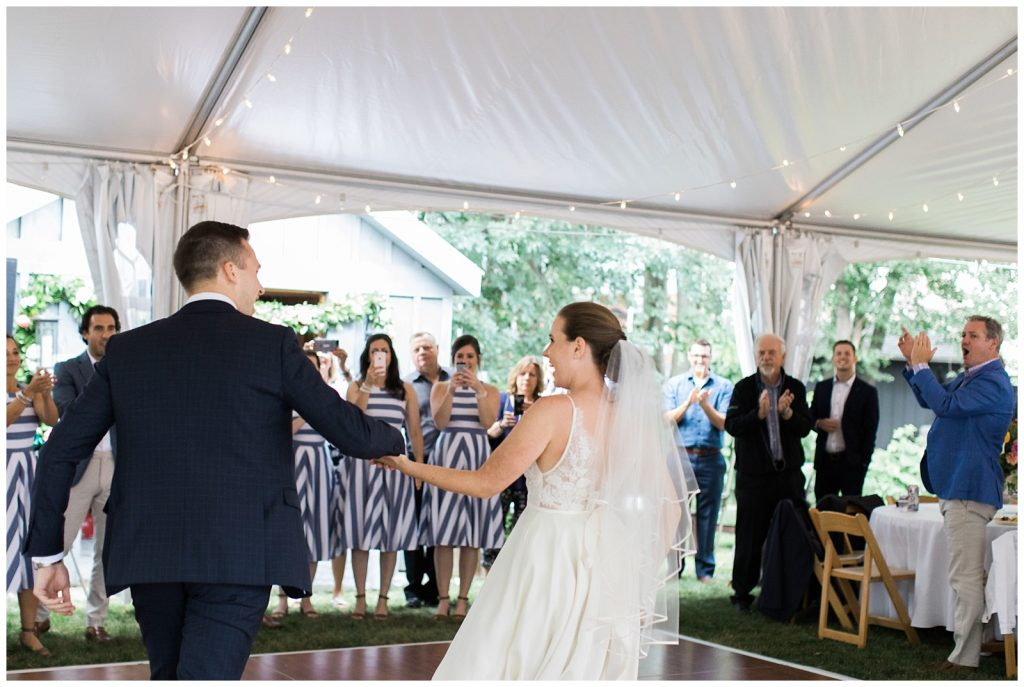 Bride and groom heading onto the dance floor for first dance at Guelph Ontario Wedding | Ontario Wedding Photographer | Toronto Wedding Photographer | 3photography