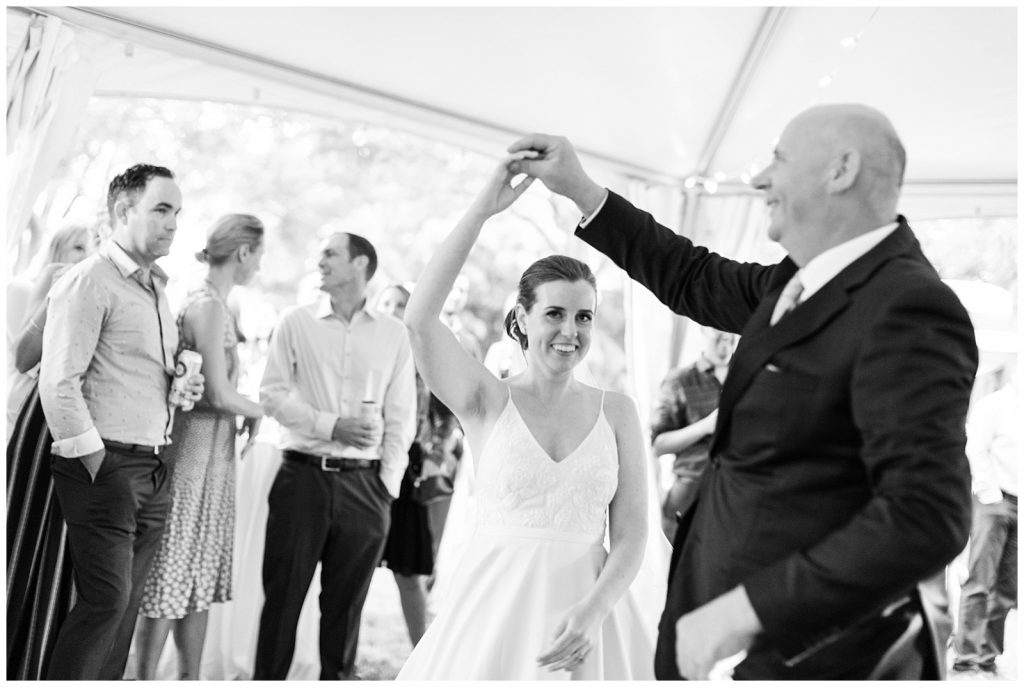 Black and white shot of bride twirling in dance with her father at Guelph Ontario Wedding | Ontario Wedding Photographer | Toronto Wedding Photographer | 3photography