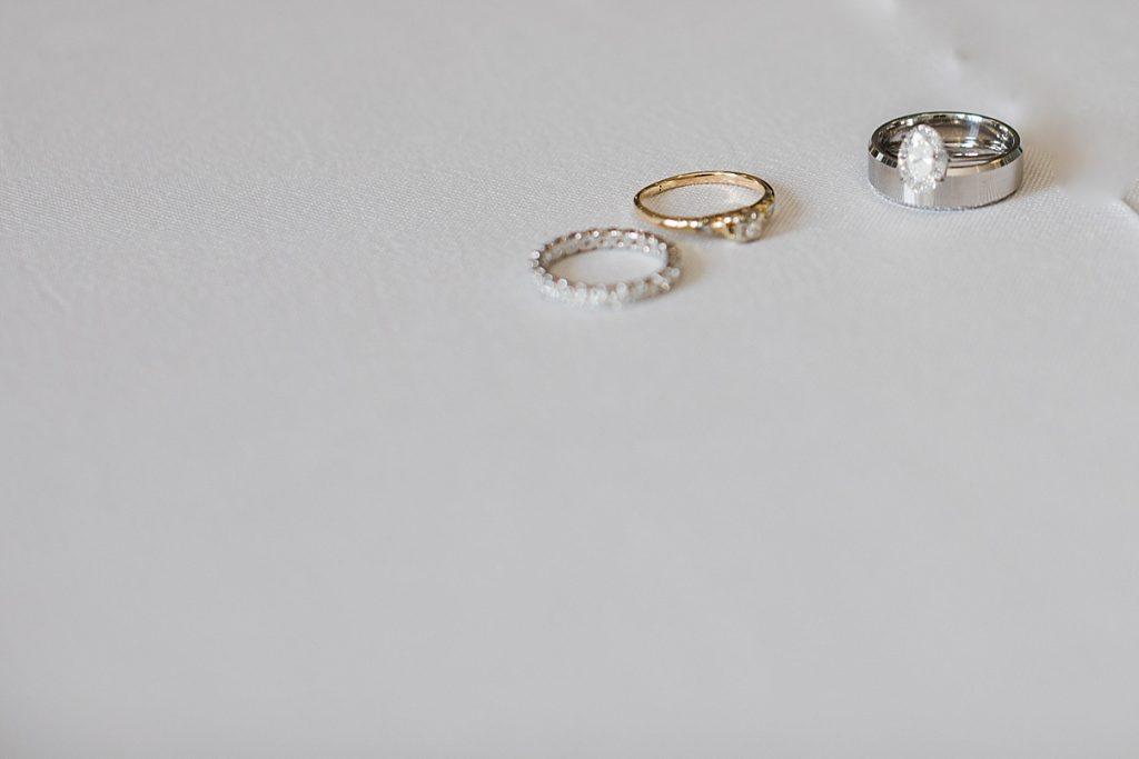 Wedding rings on table| Harding Waterfront Estate Wedding| Ontario wedding photographer| Toronto wedding photographer| 3 Photography | 3photography.ca