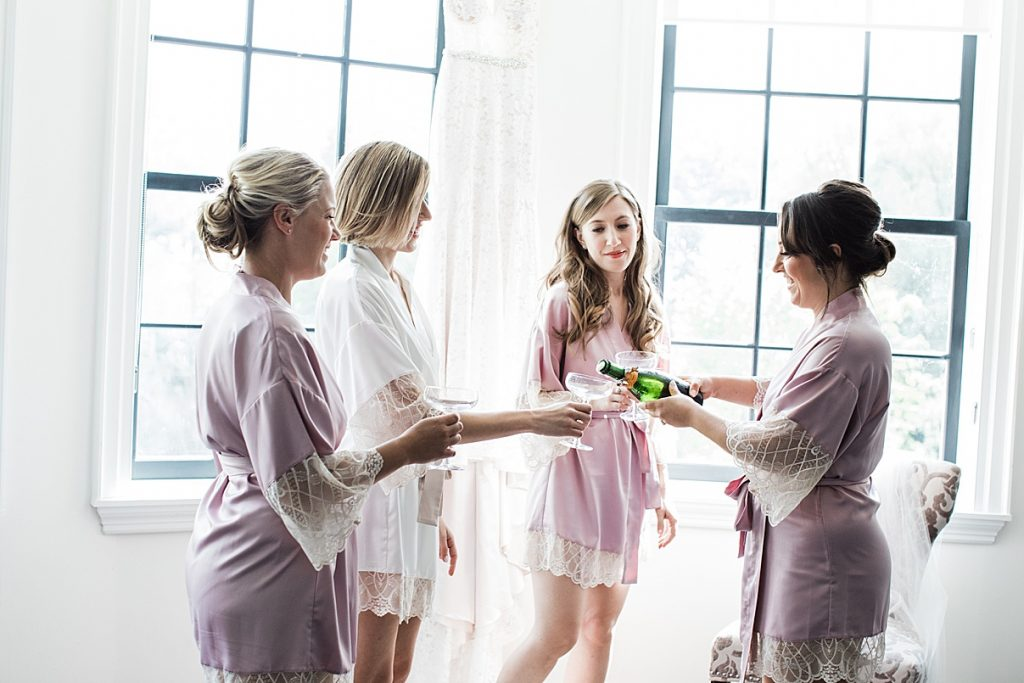 Bride and bridesmaids toasting while getting ready| Harding Waterfront Estate Wedding| Ontario wedding photographer| Toronto wedding photographer| 3 Photography | 3photography.ca