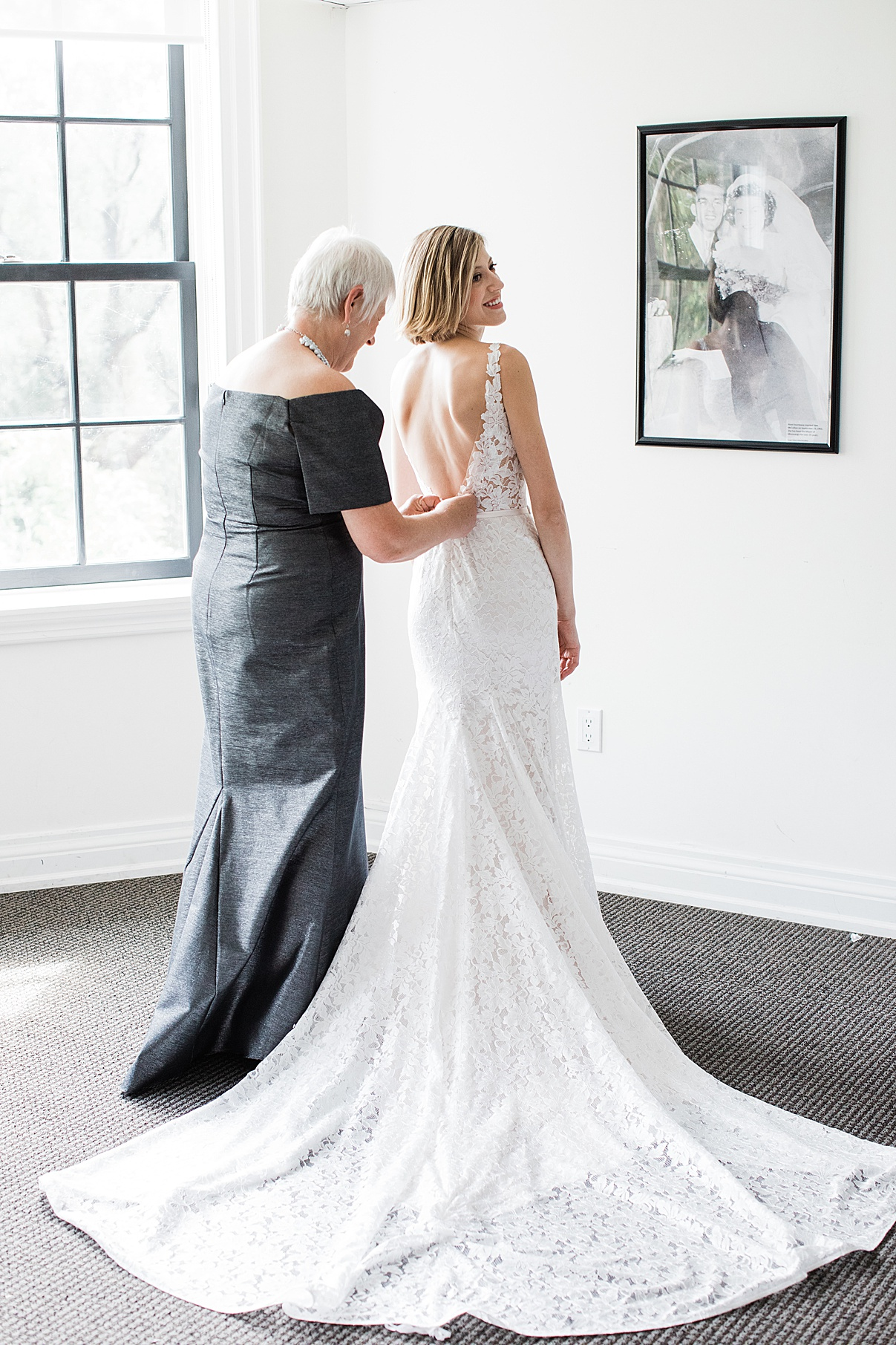 Bride and mother zipping her into dress| Harding Waterfront Estate Wedding| Ontario wedding photographer| Toronto wedding photographer| 3 Photography | 3photography.ca