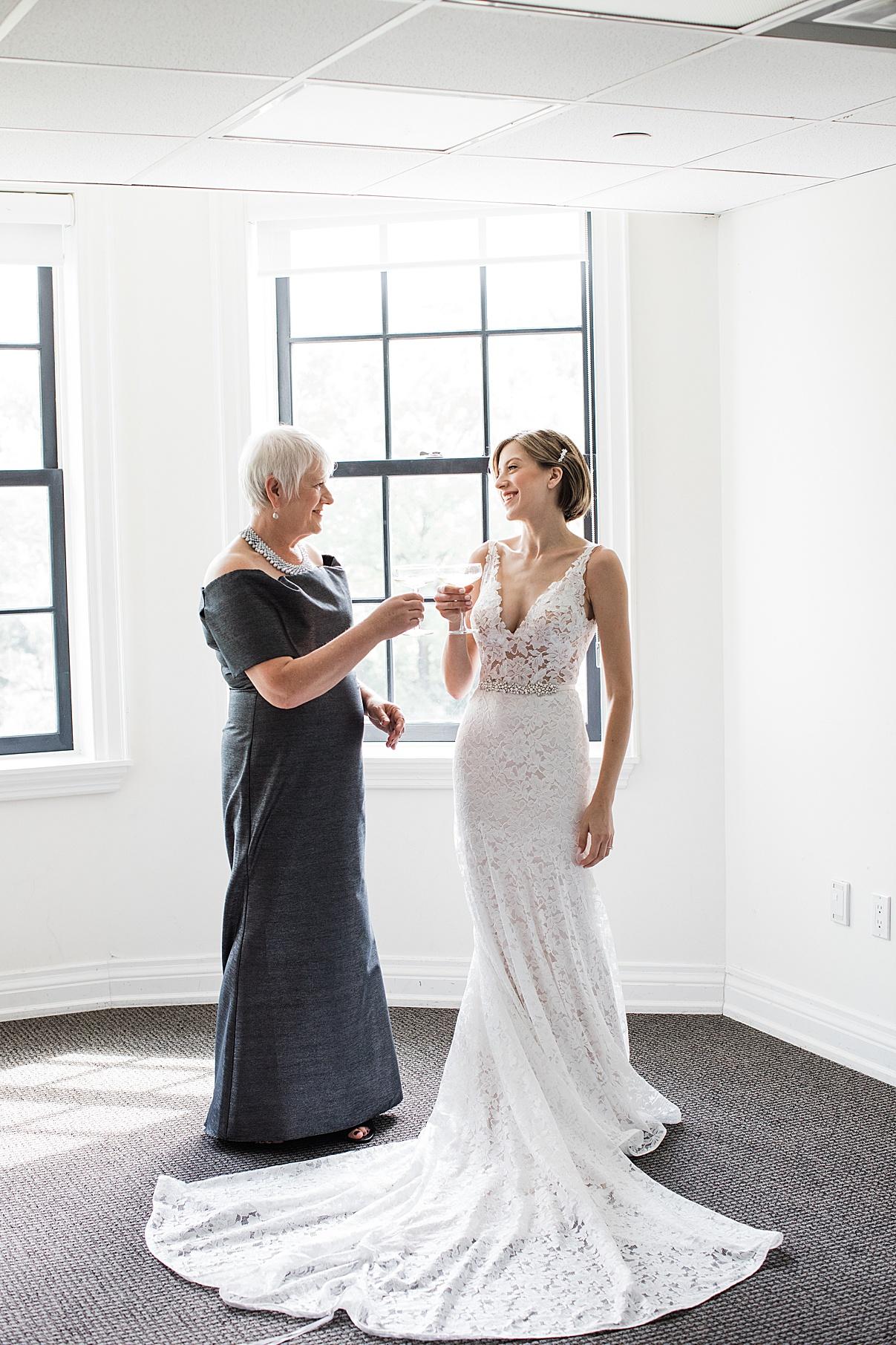 Bride toasting with her mom| Harding Waterfront Estate Wedding| Ontario wedding photographer| Toronto wedding photographer| 3 Photography | 3photography.ca