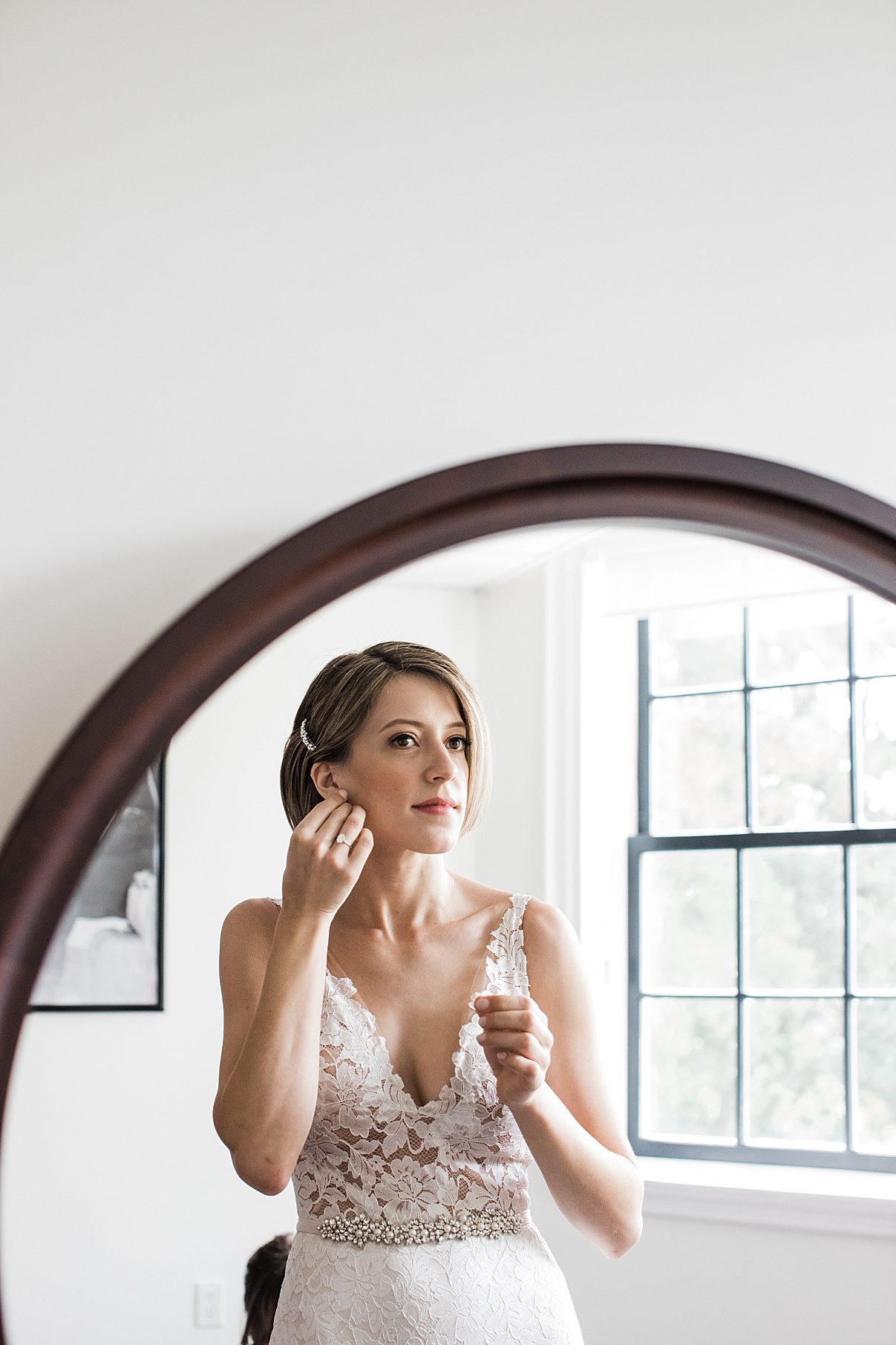 Bride putting earrings on in mirror| Harding Waterfront Estate Wedding| Ontario wedding photographer| Toronto wedding photographer| 3 Photography | 3photography.ca