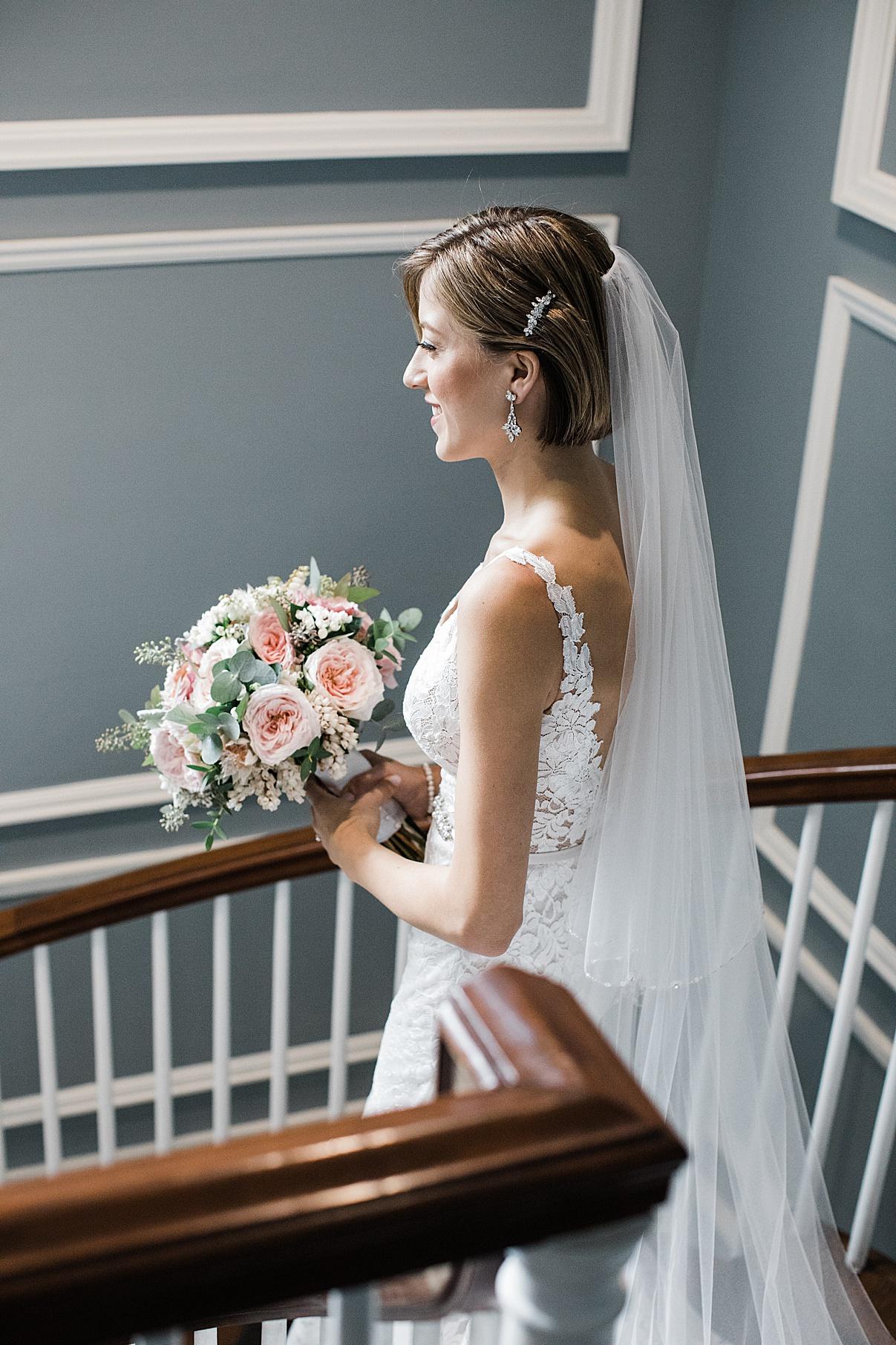 Bride at top of stairs| Harding Waterfront Estate Wedding| Ontario wedding photographer| Toronto wedding photographer| 3 Photography | 3photography.ca