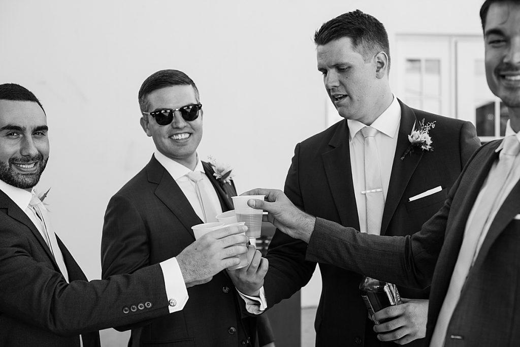 Black and white shot of guys toasting| Harding Waterfront Estate Wedding| Ontario wedding photographer| Toronto wedding photographer| 3 Photography | 3photography.ca