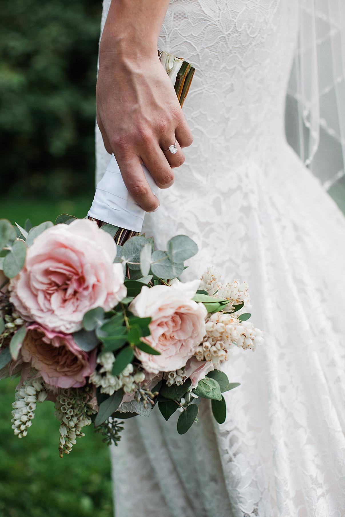 Bride holding gorgeous bridal bouquet down by train of dress| Harding Waterfront Estate Wedding| Ontario wedding photographer| Toronto wedding photographer| 3 Photography | 3photography.ca