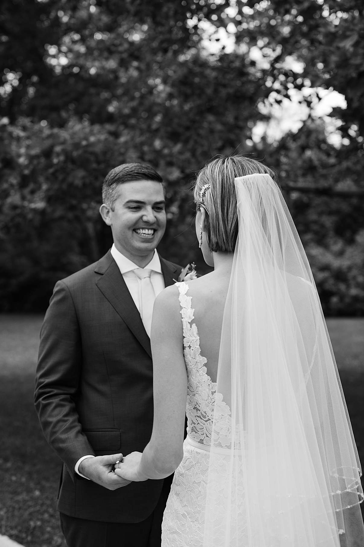 Black and white shot of groom's face after seeing bride for first look| Harding Waterfront Estate Wedding| Ontario wedding photographer| Toronto wedding photographer| 3 Photography | 3photography.ca