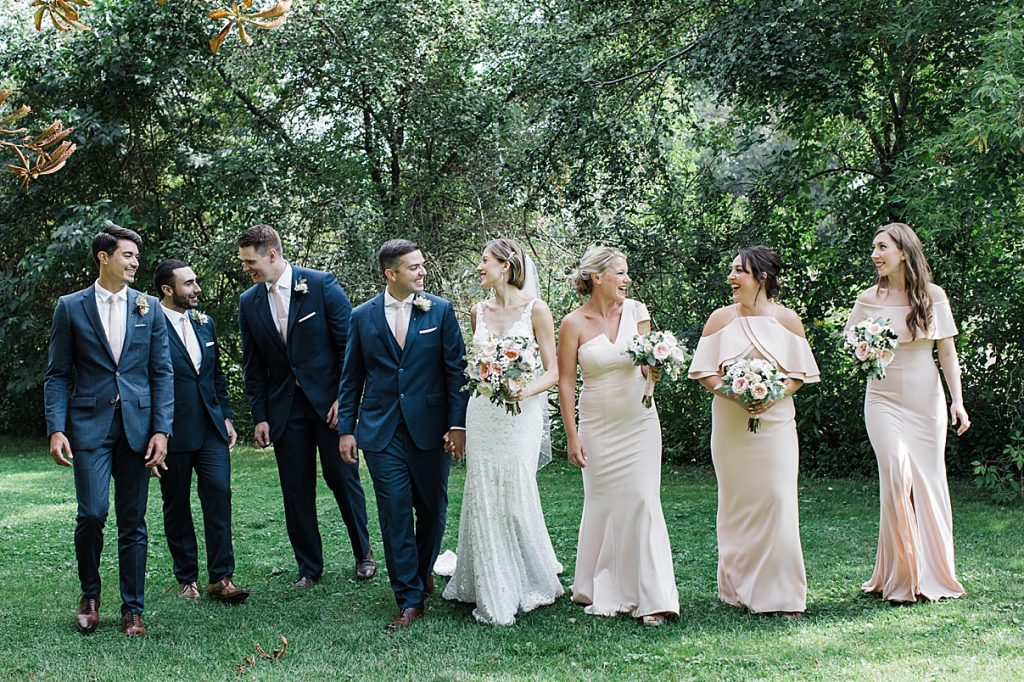 Bridal party walking and laughing| Harding Waterfront Estate Wedding| Ontario wedding photographer| Toronto wedding photographer| 3 Photography | 3photography.ca