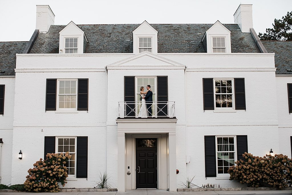 Bride and groom on balcony of mansion| Harding Waterfront Estate Wedding| Ontario wedding photographer| Toronto wedding photographer| 3 Photography | 3photography.ca
