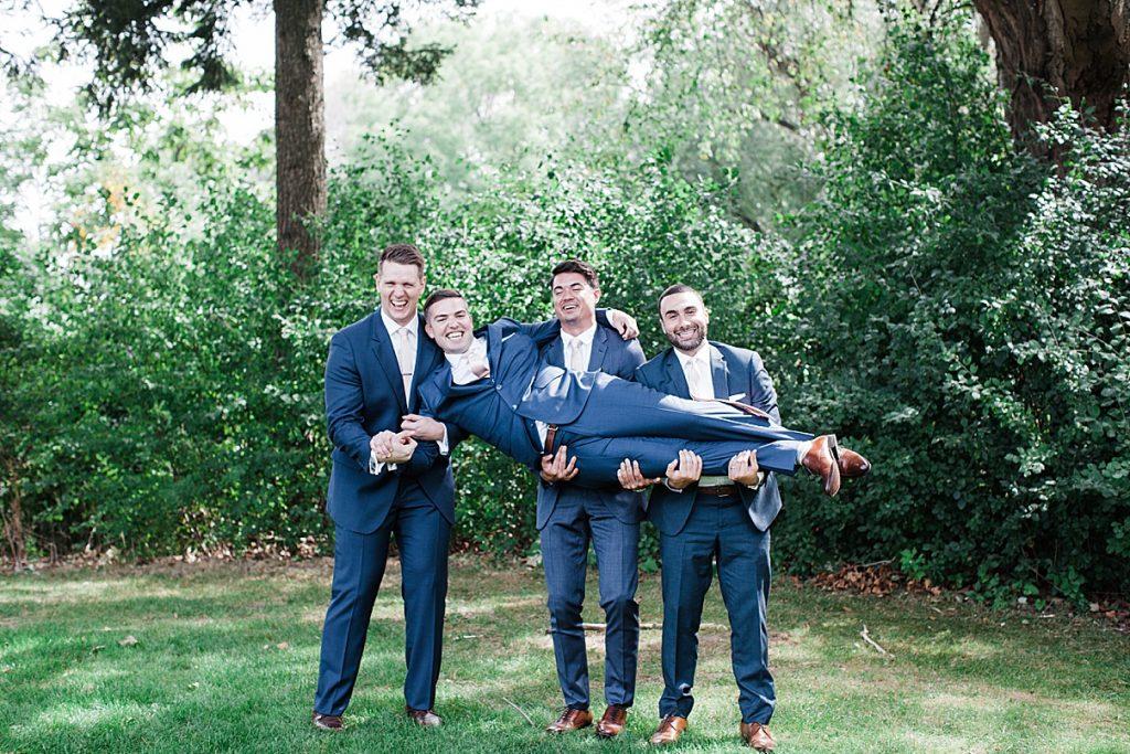 Groomsmen hold up groom| Harding Waterfront Estate Wedding| Ontario wedding photographer| Toronto wedding photographer| 3 Photography | 3photography.ca