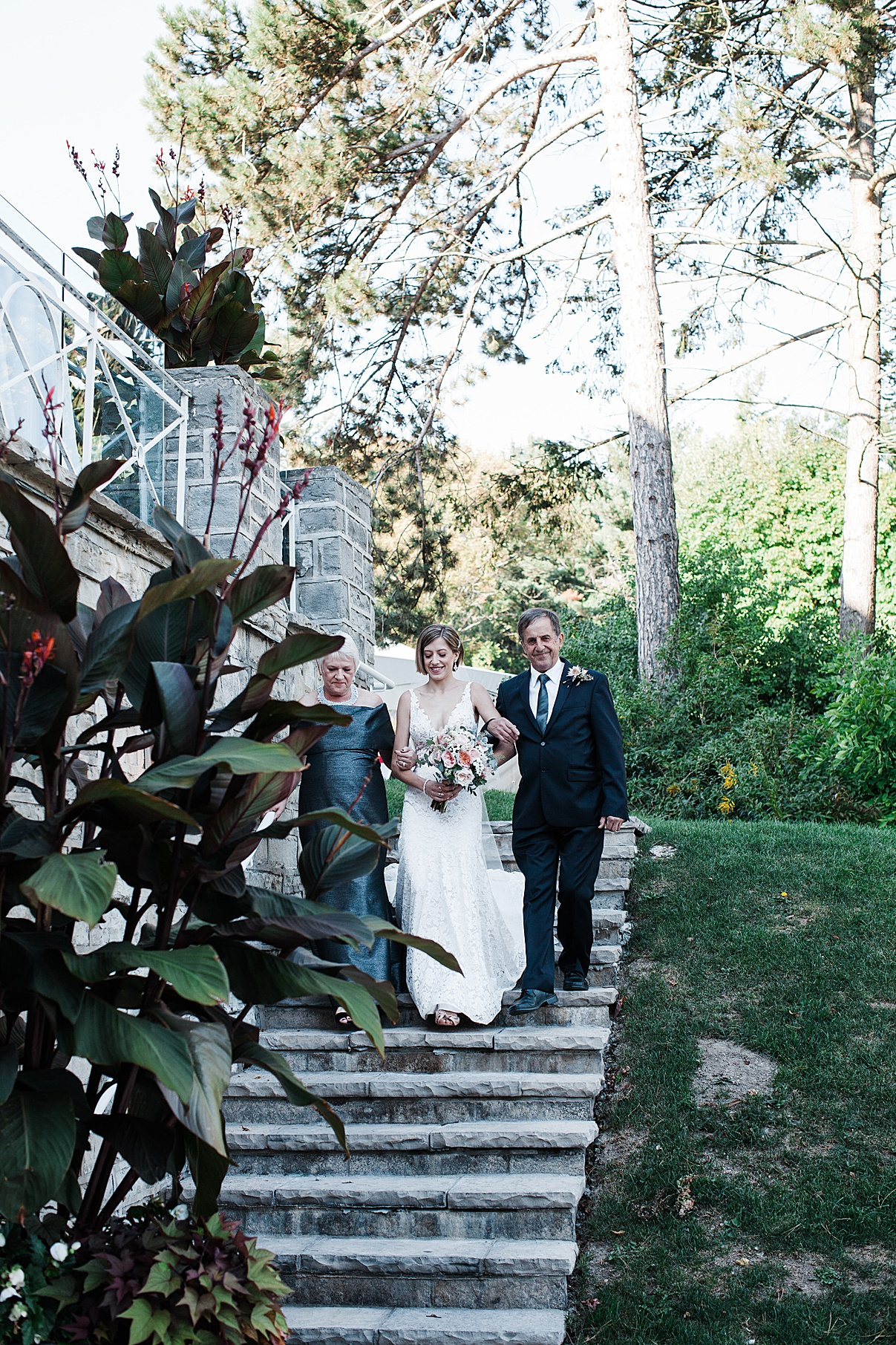 Bride walking down steps with parents| Harding Waterfront Estate Wedding| Ontario wedding photographer| Toronto wedding photographer| 3 Photography | 3photography.ca