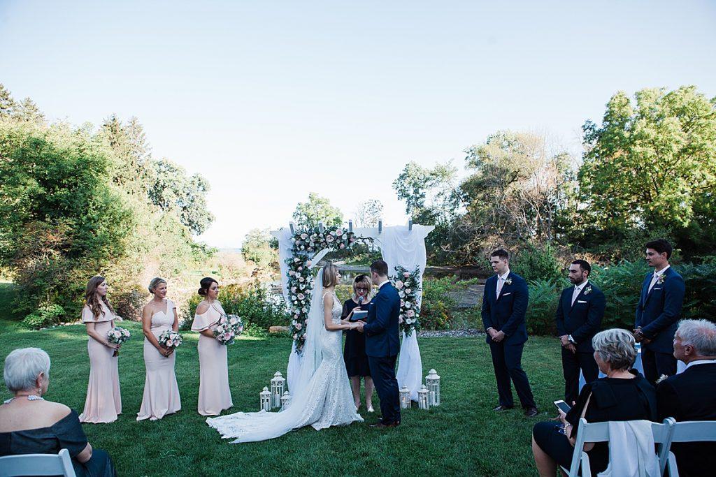 Groom ad bride hold hands at alter| Harding Waterfront Estate Wedding| Ontario wedding photographer| Toronto wedding photographer| 3 Photography | 3photography.ca