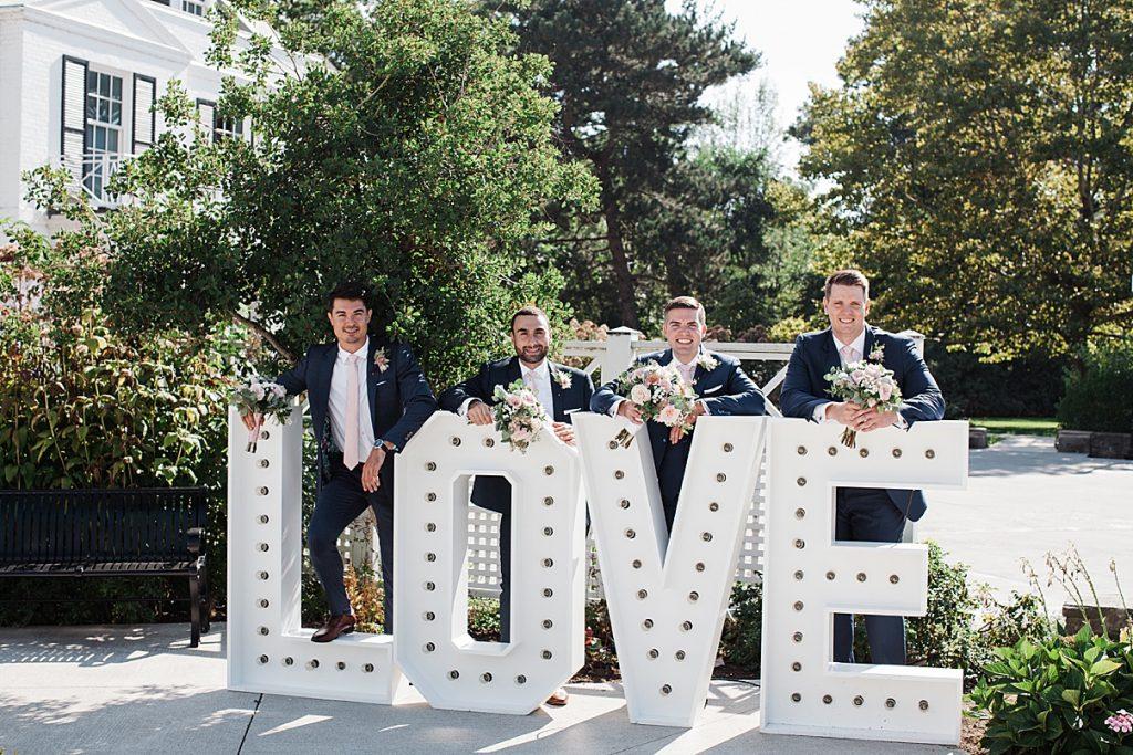 Groom and groomsmen with LOVE marquee| Harding Waterfront Estate Wedding| Ontario wedding photographer| Toronto wedding photographer| 3 Photography | 3photography.ca