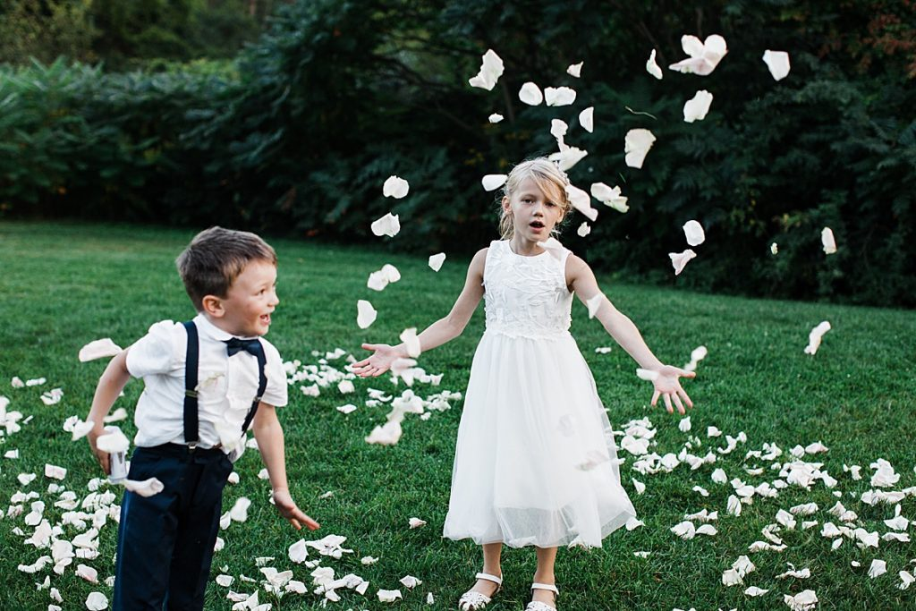 Flower girl and ring barer play in rose petals| Harding Waterfront Estate Wedding| Ontario wedding photographer| Toronto wedding photographer| 3 Photography | 3photography.ca
