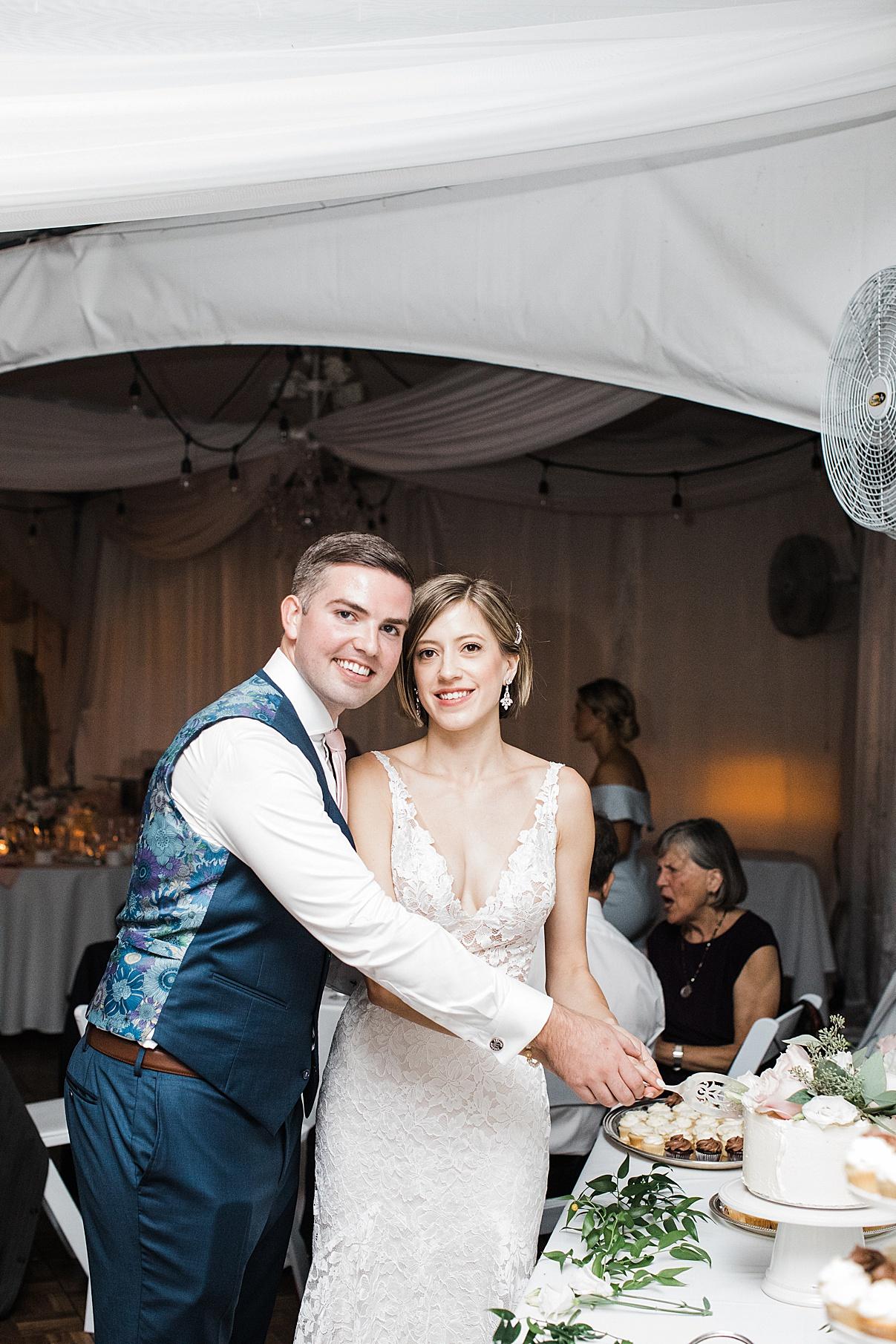 Bride and groom cut cake| Harding Waterfront Estate Wedding| Ontario wedding photographer| Toronto wedding photographer| 3 Photography | 3photography.ca