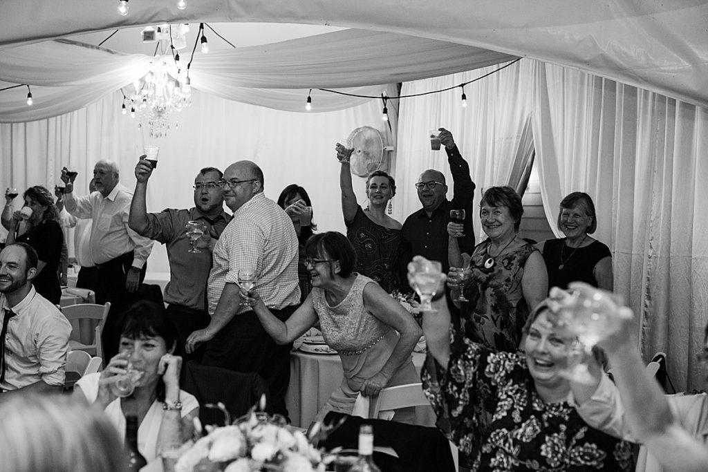 Black and white shot of wedding party toasting| Harding Waterfront Estate Wedding| Ontario wedding photographer| Toronto wedding photographer| 3 Photography | 3photography.ca