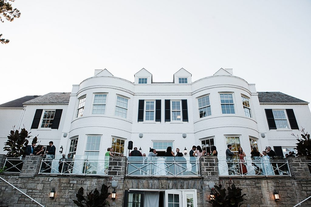 Guests on balcony of mansion| Harding Waterfront Estate Wedding| Ontario wedding photographer| Toronto wedding photographer| 3 Photography | 3photography.ca