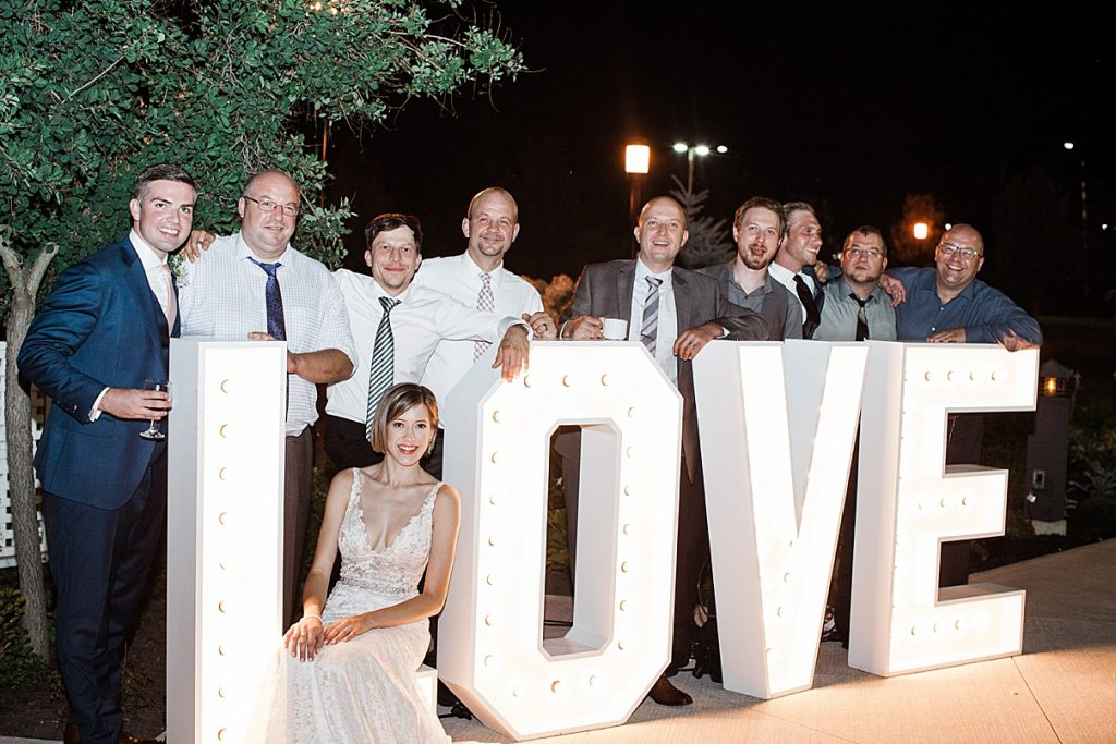 Wedding guests pose with LOVE marquee| Harding Waterfront Estate Wedding| Ontario wedding photographer| Toronto wedding photographer| 3 Photography | 3photography.ca