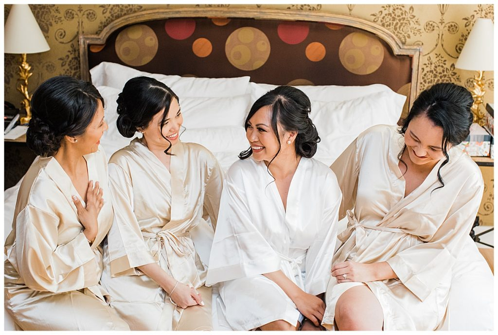Bride and bridesmaids laughing on bed| The George Restaurant Wedding| Toronto Wedding Photographer| Ontario wedding photographer| 3photography