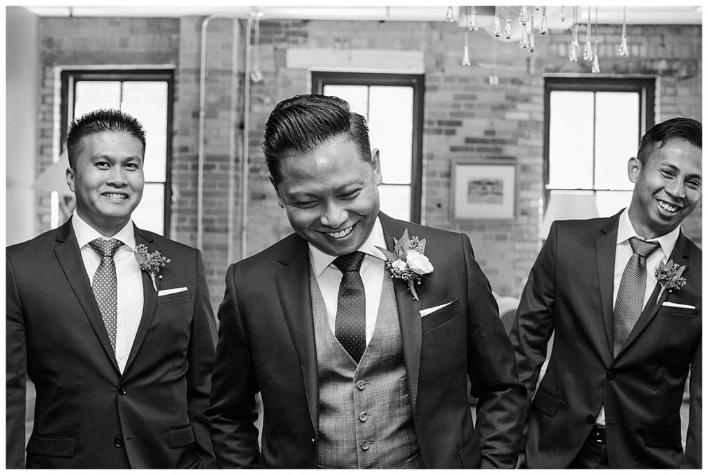 Black and white shot of groom laughing with groomsmen| The George Restaurant Wedding| Toronto Wedding Photographer| Ontario wedding photographer| 3photography