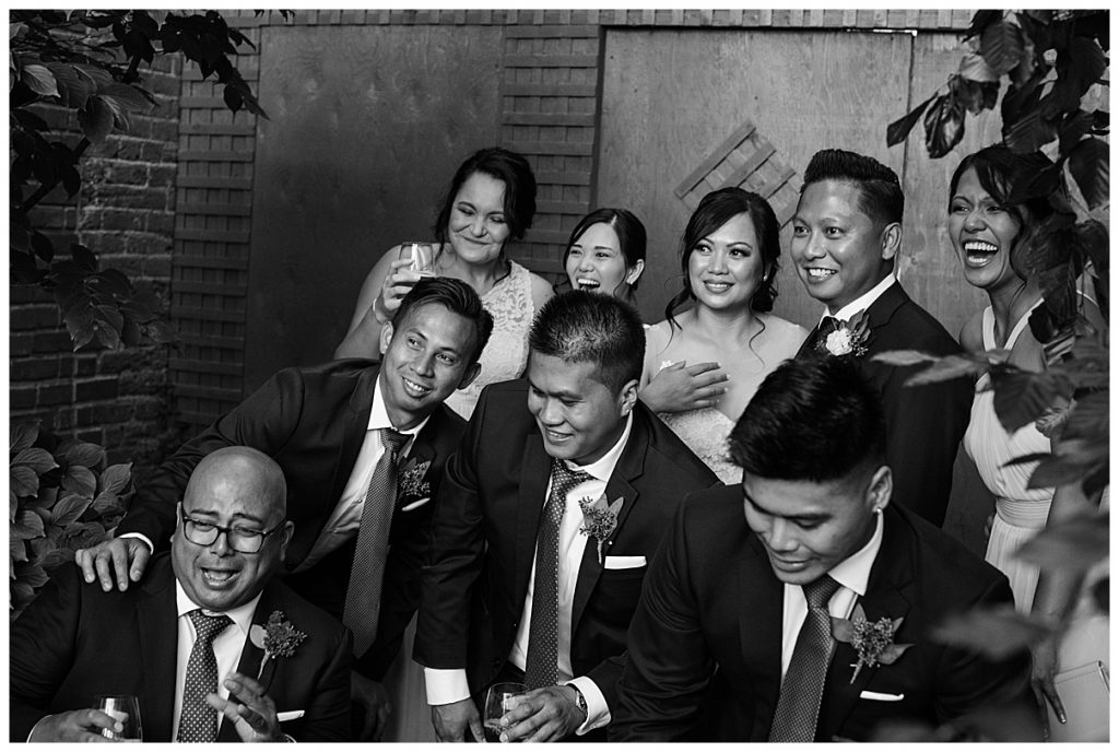 Black and white shot of bride and groom with guests| The George Restaurant Wedding| Toronto Wedding Photographer| Ontario wedding photographer| 3photography
