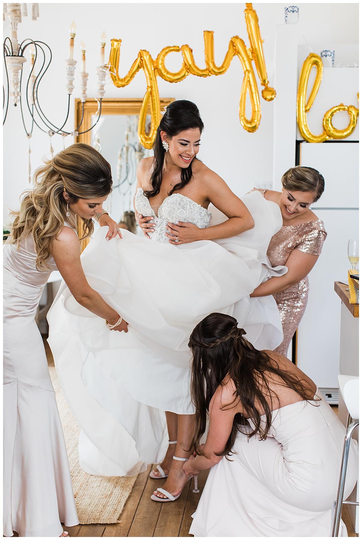 Bridesmaids helping bride put shoes on| Belcroft Estate Wedding| Toronto wedding photographer| Ontario wedding photographer| 3photography
