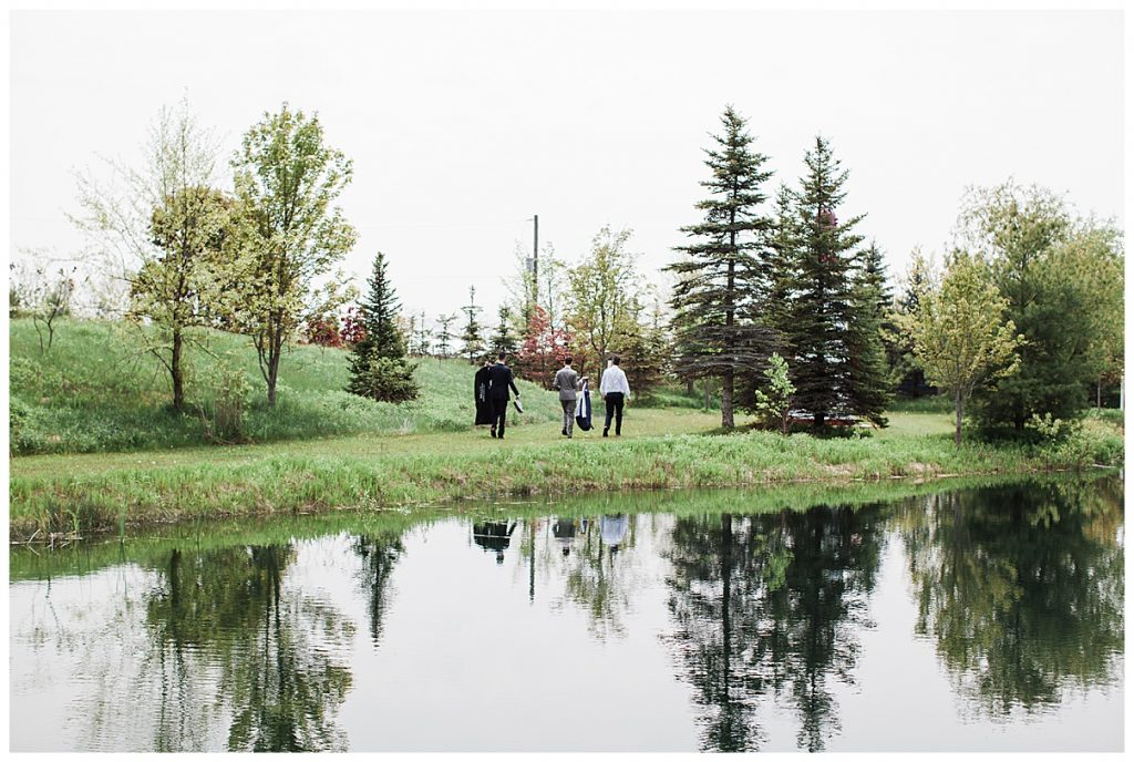 Groomsmen walking away with pond and trees behind them| Belcroft Estate Wedding| Toronto wedding photographer| Ontario wedding photographer| 3photography