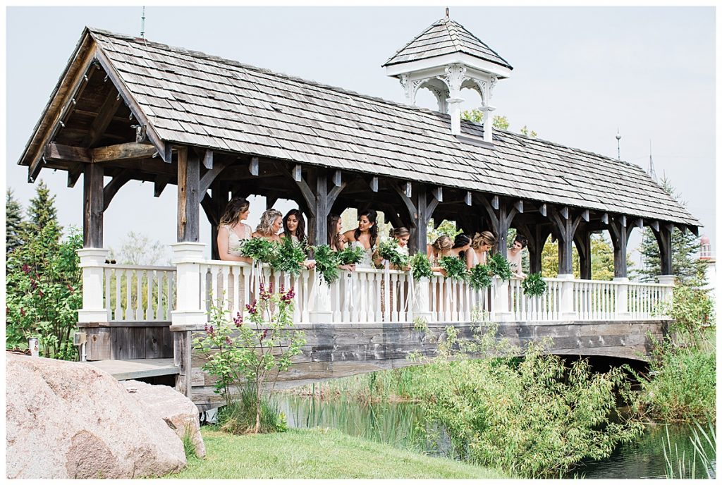 Bridesmaids leaning out over bridge|  Toronto wedding photographer| Ontario wedding photographer| 3photography